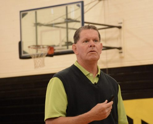 Jim Marshall speaking at a high school