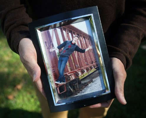 Jim Marshall holds a picture of his son, Cody Marshall, at the Capitol. Cody died of a drug overdose. Photo by Shelby Kardell /News Tribune.