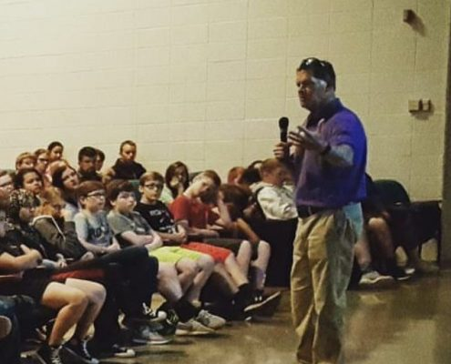 Jim Marshall speaking to kids group